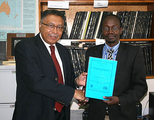 Jean-Paul Deprins and Prof. George Chemining'wa showing a signed MoU